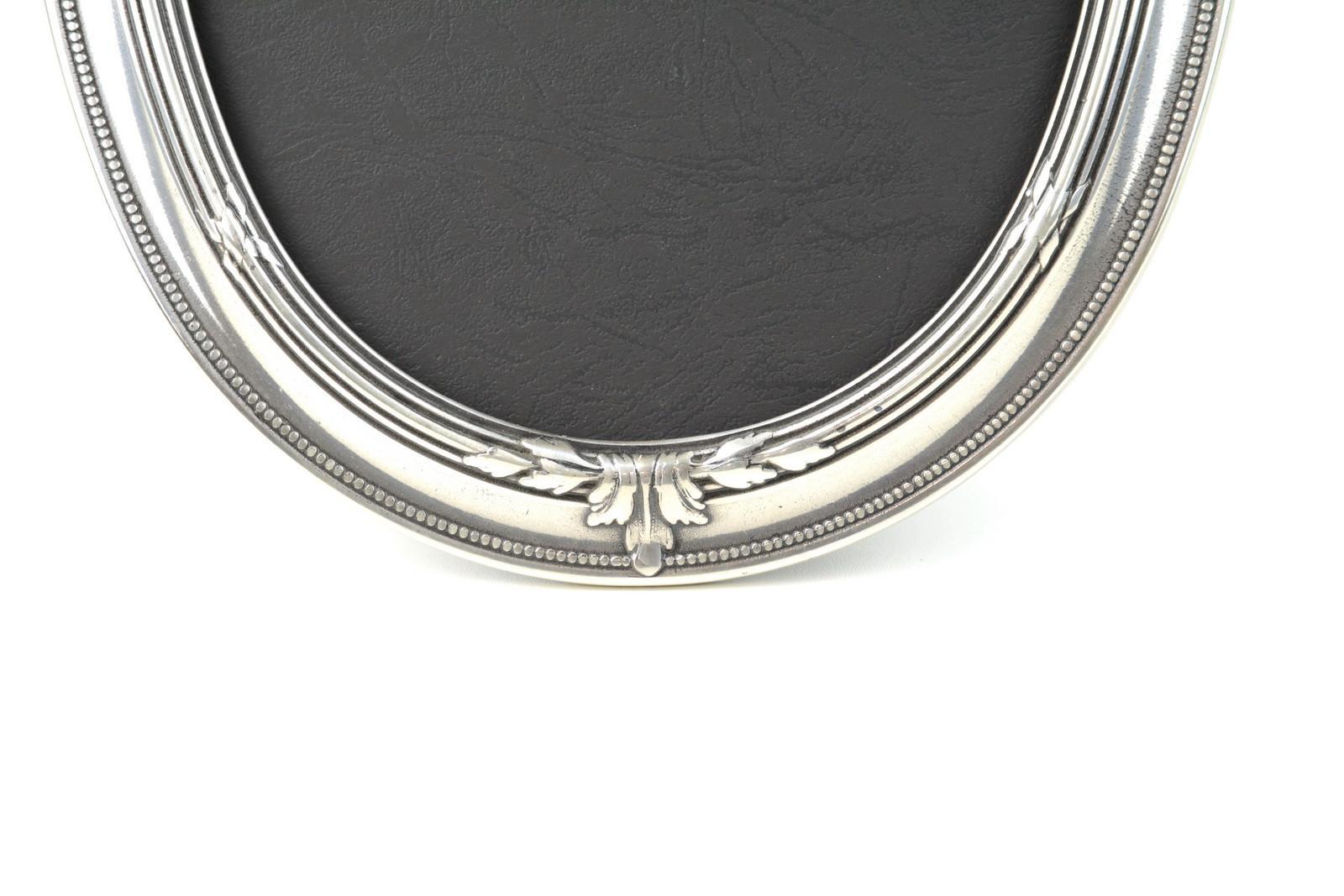 cornice-portafoto-ovale-ottone-massiccio-argentato-retro-in-plastica-4,2655.jpg?WebbinsCacheCounter=1